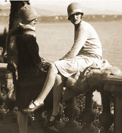 young ladies dressed in the fashions of the 1920s, knee length skirts, kitten heels, cloche hats
