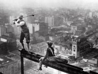 Golfers on a new york city skyscraper