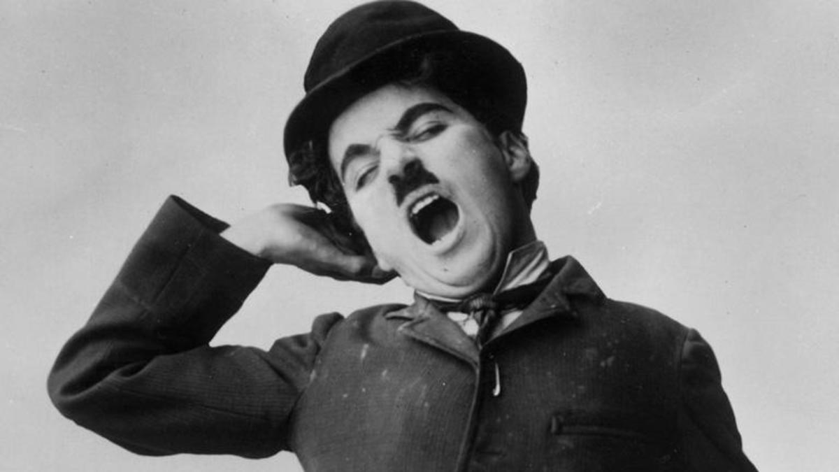 Charlie Chaplin in his iconic outfit complete with bowler hat