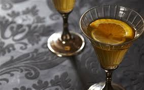 1920's cocktails were extravagent, not only to mask the abhorrent taste of the illegally created alcohol but also to match the costume of the era