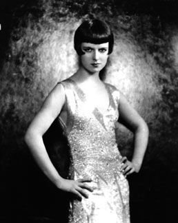 Louise Brooks, hands on hips, looking fierce.