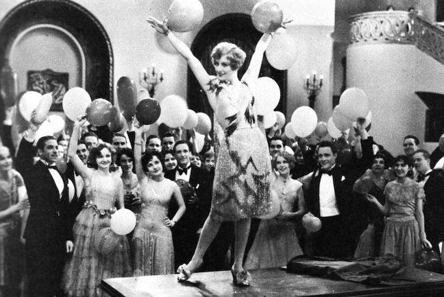a classy 1920s party complete with flappers and balloons